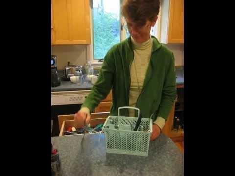 Grace putting the utensils away